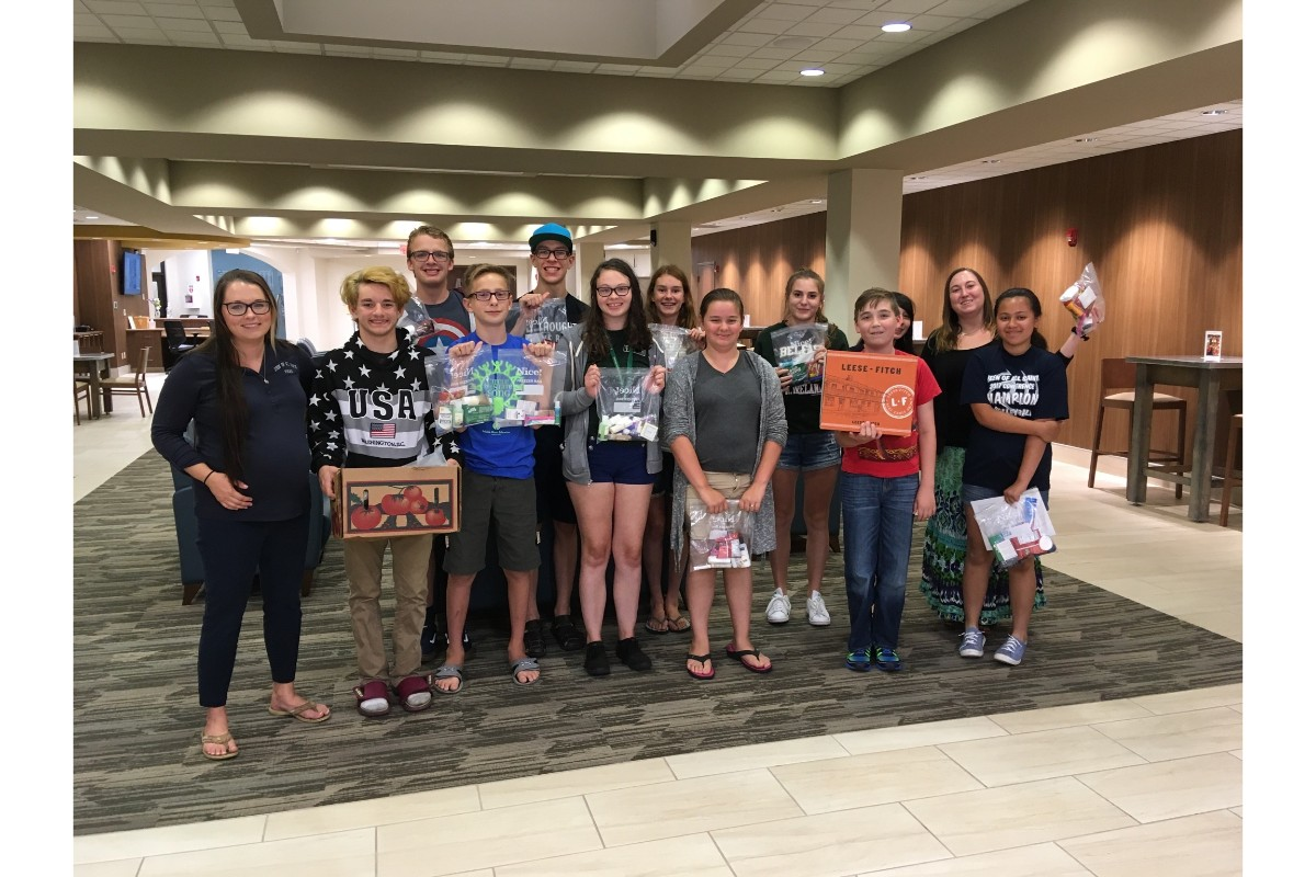 Queen of All Saints Catholic Church Teens Donate Blessing Bags to Homeless
