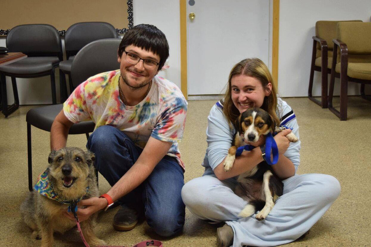 LIFER Drew Holt Couldn't Help But to Adopt a Dog from Lakeshore PAWS After Covering Event